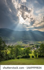 Sun rays or crepuscular rays over the mountains of the Alps in Austria
