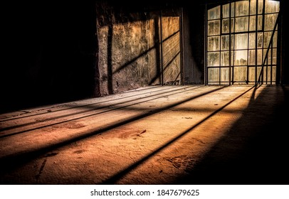 Sun rays fall through tall windows into an abandoned dusty room. Sunlight window in darkness. Dark sunlight window. Tall window sunlight - Shutterstock ID 1847679625