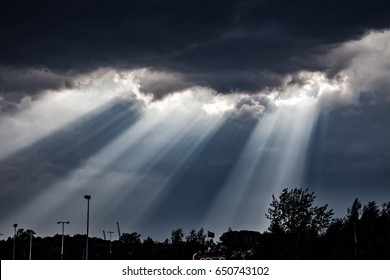 Sun Rays falling through the Clouds.