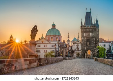 Sun rays filling the scene with colors during sunrise on empty deserted Charles bridge in Prague, Czech Republic  - Shutterstock ID 1721143243