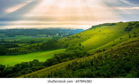 Sun rays over a hill
