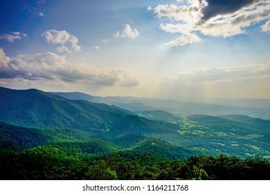 sun rays over mountains