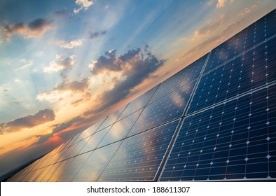 Sun rays over a photovoltaic power plant