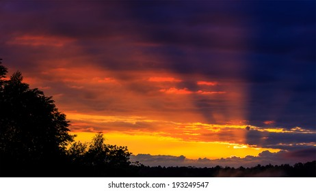 The Sun Rays Passing Through The Clouds After The Sunset, Unusual Dramatic Cloudscape