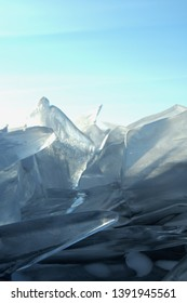 Sun rays are refracted by the transparent ice of Lake Baikal. crystal clear ice fragments — hummocks