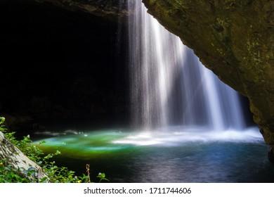 Sun Rays Shining through a Cave Waterfall at Natural Bridge in Springbrook National Park