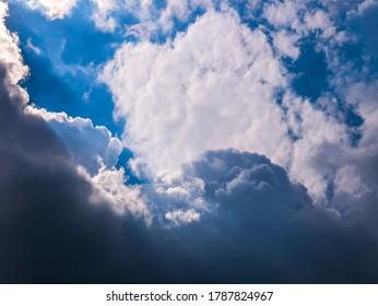 Sun rays shining through thick cloudy sky