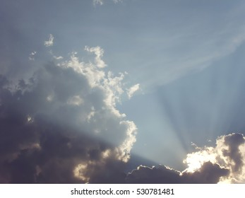 The sun rays in the sky