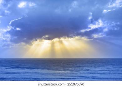 sun rays streaming through the storm clouds on the Irish wild Atlantic way