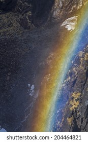 Sun rays which  meet on the fine dust of the waterfall that shine in the glorious colors of the rainbow