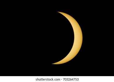 The Sun reappears with a crescent shape from behind the moon during the August, 2017 Total Eclipse.