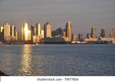 The sun reflects off of a downtown tower in San Diego, California.
