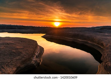 Sun rise in the morning shade the yellow orange colors at 3000 holes or boke in Ubon ratchathani province Thailand one of the popular place of Mae khong river for yours holidays or vacation