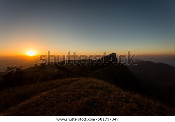 Sun rise on dry grass on the mountain at doi monjong, chiangmai, thailand