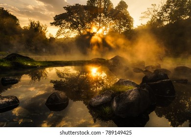 Sun rise over the hot springs in National Park with natural mineral water