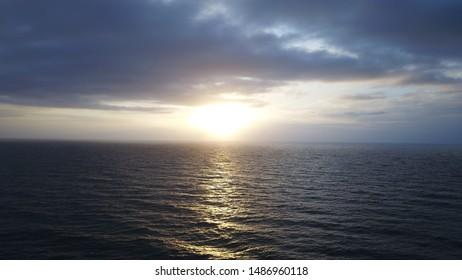 Sun rise over the ocean  - Shutterstock ID 1486960118