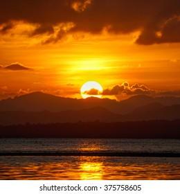 Sun rise and the sea.