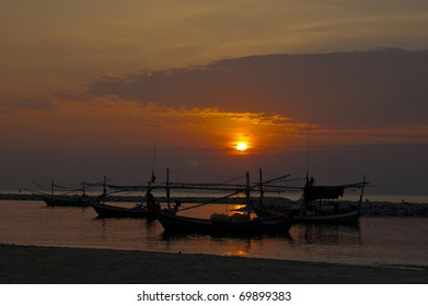 Sun rise with three boats