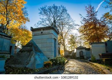 The sun rises above famed cemetery Père Lachaise in Paris, France during autumn