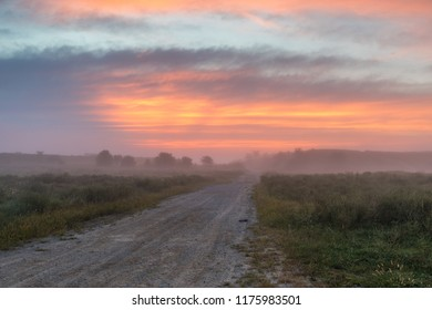 The sun rises above a rural road in Central Appalachia.