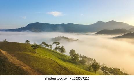 The sun rises with beautiful colors at Thien Phuc Duc hill, Da Lat - Viet Nam.