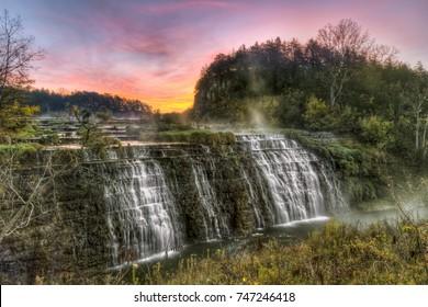The sun rises behind Thunder Bay Falls near Galena, Illinois.