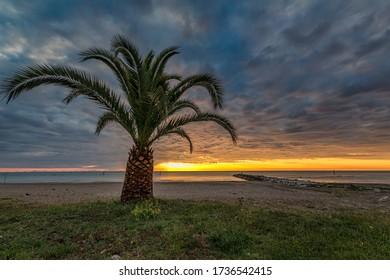The sun rises over the Adriatic sea. Photo taken by Grottammare