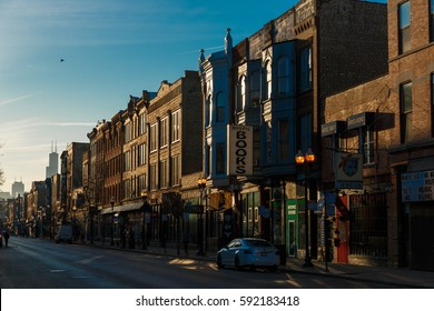 The sun rises over Chicago's Wicker Park / Bucktown neighborhood and an empty North Milwaukee Avenue, on February 17, 2017.