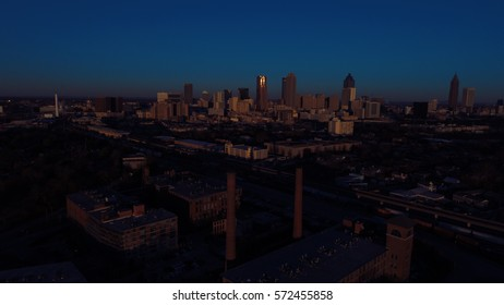 As the Sun Rises over the City of Atlanta, a Very Faint light emerges,  Aerial View