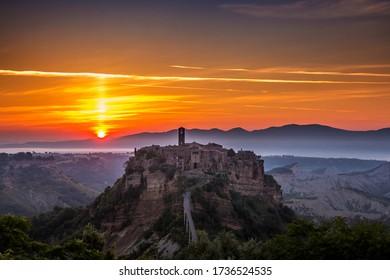The sun rises over Civita di Bagnoregio
