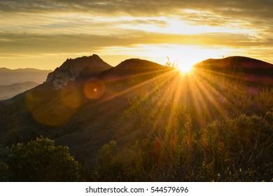 The sun rises over Hollister Peak in Morro Bay, California.