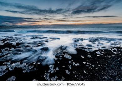 Sun rises over Ice beach at Jokulsarlon
