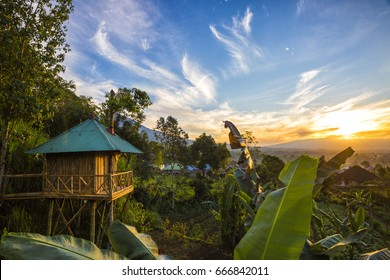 The sun rises over a jungle treehouse in the middle of Indonesian island Bali