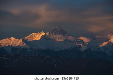 The sun rises over Mount Everest and the rest of the Himalayas.