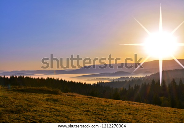 The sun rises over the mountains