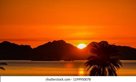 Sun rises over the mountains of San Carlos, Sonora, Mexico.