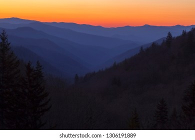 The sun rises over multiple ridges and valleys in the Smoky Mountains at Newfound Gap near the border of Tennessee and North Carolina.