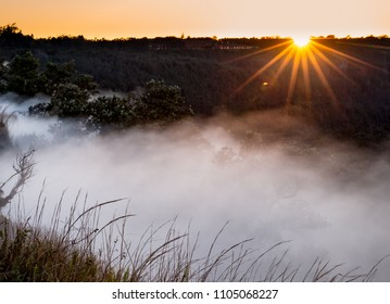 Sun rises over Steaming bluff overlook in Kilauea Crater.