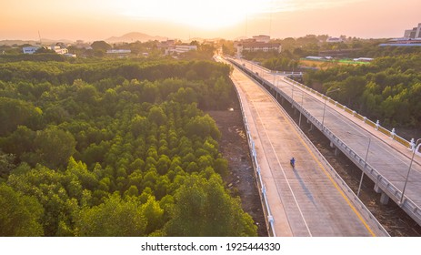 The sun rises over Thepsrisin Bridge. Thepsrisin Bridge is a shortcut to connect the city from Saphan Hin intersection with Sakdidet intersection in order to reduce the bad traffic congestion.