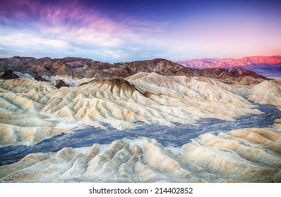 The sun rises over Zabriskie Point in Death Valley National Park, California, USA