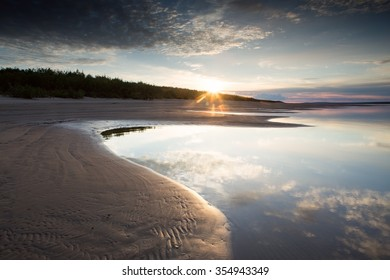 The sun rising above the river. Lena river. Yakutia. Russia.