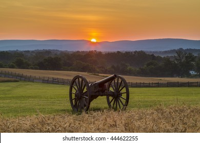 Sun rising behind artillery near a wheat field at Antietam National Battlefield in Sharpsburg, Maryland. The battle at Antietam was the bloodiest single-day battle in American history.