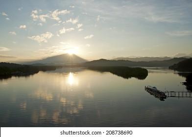 Sun rising from behind the mountain at Tuaran, Sabah, Mlaysia