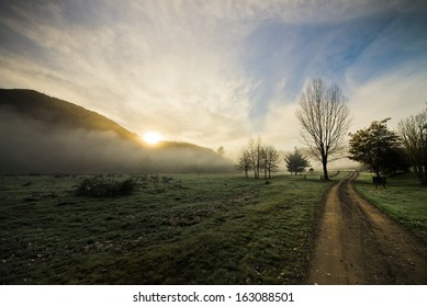 Sun rising up with early morning mist around mountains, Hastings, New Zealand