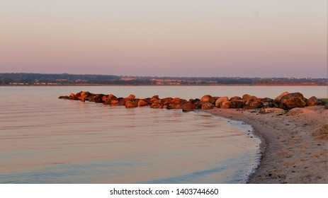 The sun is rising and makes a beautiful red color in the water
