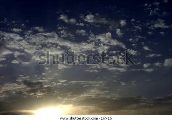 sun rising on a cludy sky
