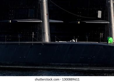The sun rising on two Japanese submarines docked in the city of Yokosuka, Japan.