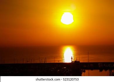 Sun rising over Barcelona harbour