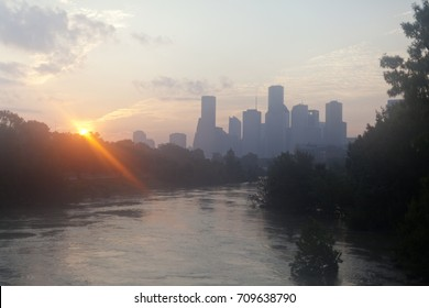 Sun rising over the city skyline in Houston, Texas with empty streets after Hurricane Harvey disaster
