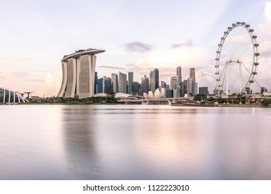 Sun rising over the downtown skyline of Singapore as viewed from across the water from The Garden East. Singapore.
